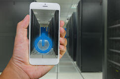 Smart phone remote command to data center. Hand hold a Smart phone for remote command to data center Stock Photos