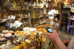 Smart Phone in Retail. A store owner checked his inventory on a smart phone Stock Photography