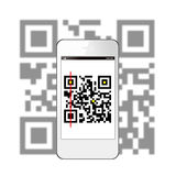 Smart phone scanning QR code Royalty Free Stock Image