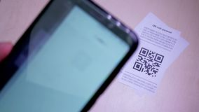 Smart phone scanning QR code in paper label. Or payment check. Concept of payment , online shopping and cashless technology stock footage