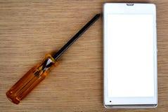 Smart phone and screwdriver for repair Stock Photo