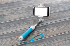 Smart phone on a selfie stick. Royalty Free Stock Photo