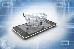 Smart phone and shopping trolley Royalty Free Stock Photography