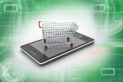 Smart phone and shopping trolley Royalty Free Stock Photo