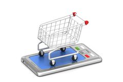 Smart phone in shopping trolley Royalty Free Stock Photo