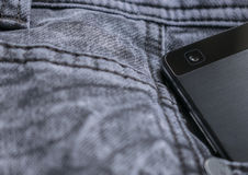 Smart phone ,smart phone camera on jeans texture. Denim background Royalty Free Stock Photos