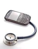 Smart phone and stethocope Stock Photo