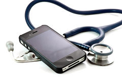 Smart phone and stethoscope on white background Stock Photos