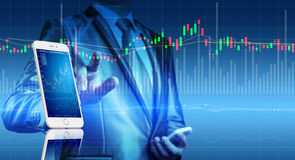 Smart phone with stock market chart, business investment Stock Photos