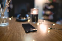 Smart Phone on Table with Decor stock image