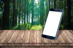 Smart phone on table forest. Smart phone on table in forest Royalty Free Stock Photos