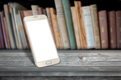Smart phone table in library. Smart phone on table in library Royalty Free Stock Photo