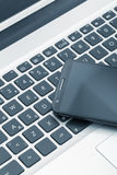 Smart phone on tablet computer. technology and communication con Stock Image