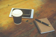 Smart phone, tablet, note book, pen and coffee Royalty Free Stock Photo
