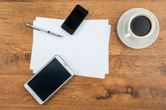 Smart Phone, tablet, paper and drawing pen with coffee Stock Photos
