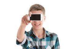 Smart Phone teenager sorridente dello spazio in bianco di rappresentazione Fotografie Stock Libere da Diritti