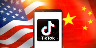 Smart phone with TIK TOK logo on National flags of the United States and China