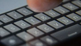 Smart phone touch screen display finger typing. Extreme close up, macro stock video