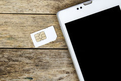 Smart phone use with micro sim card Royalty Free Stock Photo