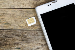 Smart phone use with micro sim card Stock Photos