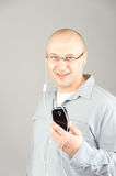 Smart phone user make a smile Stock Images