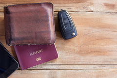 Smart phone,wallet,passport and car key on wooden table Stock Photography