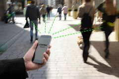 Free Smart Phone With Corona Warn App, The Contact Tracking Or Tracing Application Against Covid 19 Pandemic Is Connecting Other Phones Royalty Free Stock Image - 186289276