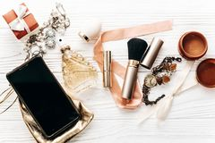 Free Smart Phone With Empty Screen And Luxury Jewelry Perfume Present Royalty Free Stock Image - 108387166