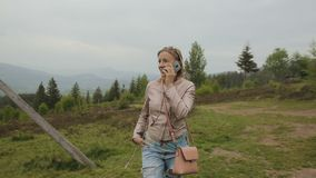 Woman talking on smartphone at mountains. Girl on mobile cell phone outside in nature. Smart phone woman calling talking on smartphone. Girl on mobile cell phone stock video footage