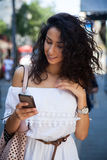 Smart phone and woman Stock Photography