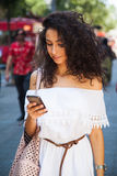 Smart phone and woman Stock Image