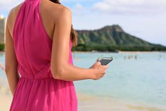 Smart phone woman using smartphone app on beach Royalty Free Stock Photos
