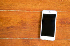 Smart phone on wooden background Stock Images