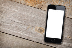 Smart phone on wooden table Stock Image