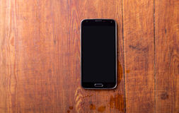 Smart phone on wooden table background Stock Image