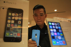 SMART PHONES APPLE. Visitors see the products apple smart phone in the iBox, Jakarta Royalty Free Stock Photography