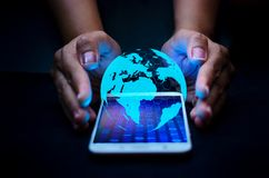 Smart Phones and Globe Connections Uncommon communication world Internet Business people press the phone to communicate in the Int stock photo