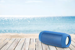 Smart phones and portable speaker on the beach. Royalty Free Stock Images