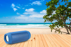 Smart phones and portable speaker on beach. Stock Photography