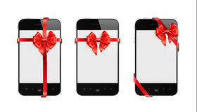 Smart Phones with red ribbons Royalty Free Stock Image