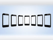 Smart-phones transparent on the light blue background Royalty Free Stock Photo