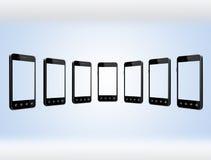 Smart-phones transparent on the light blue background Stock Photos