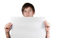 Smart pojke med arket av papper som isoleras på vit Royaltyfri Fotografi