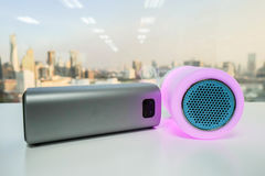 Smart portable music speaker light in pink purple color with wireless bluetooth speaker Stock Photo
