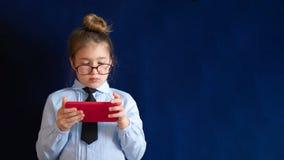 Smart preschool girl holding smartphone stock photo