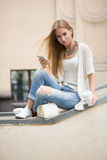 Smart professional woman reading using phone Stock Photography