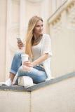 Smart professional woman reading using phone Royalty Free Stock Photo