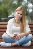Smart professional woman reading using phone Royalty Free Stock Photos
