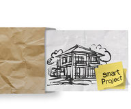 Smart project sticky note with house crumpled Stock Image