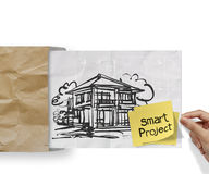 Smart project sticky note with house crumpled envelope paper Stock Photo